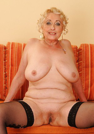 Fatty granny Pamela Peach taking off her lingerie and spreading her legs