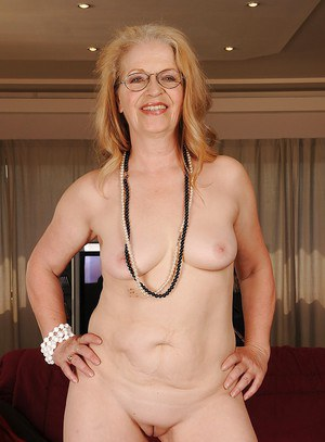 Naughty granny in glasses revealing her big flabby jugs and shaved cunt