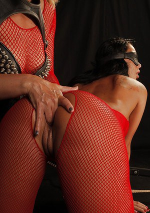 Blindfolded brunette in pantyhose suit gets tortured by a blonde femdome