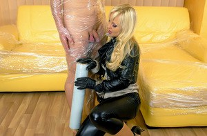 Lusty chick in latex Sharka Blue teasing her male pet stiff cock
