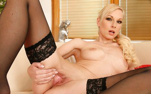 Hot blonde babe Lena Cova stripping and exposing her pink pussy
