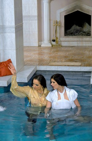 Fully clothed european vixens have some lesbian fun in the pool