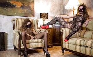 Lusty lesbians in pantyhose suits playing with their sex toys