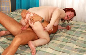 Lecherous redhead granny with hairy twat gets fucked by a younger guy