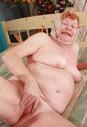Filthy fatty granny with flabby tits stripping and spreading her legs