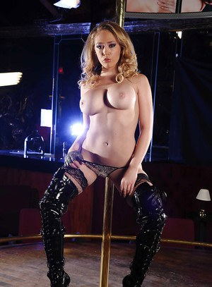 Voluptuous blonde babe in high heeled boots dancing striptease