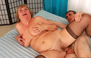 Fatty granny in stockings gives a blowjob and gets fucked hardcore
