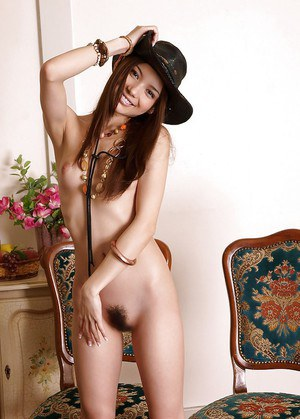 Lovely teenage asian cowgirl with slender legs stripping off her clothes