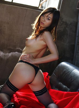 Sexy asian babe in stockings Hikaru Koto taking off her top and lacy panties