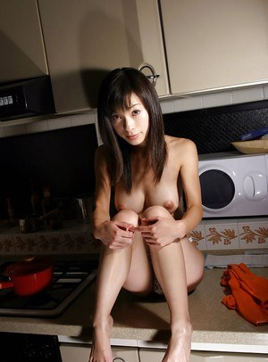 Flirtatious asian babe in lacy panties showcasing her tempting body