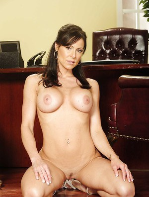Bosomy MILF Kendra Lust stripping off her dress and lacy panties