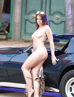 Voluptuous babe Penny Flame stripping off her clothes outdoor
