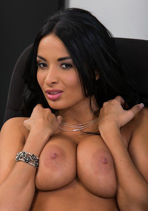 Bosomy latina babe Anissa Kate slipping off her suit and lingerie