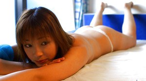Tempting asian coed with puffy nipples stripping on the bed