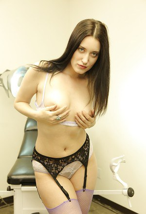 Hot ass gal Kimberly Kane uncovering her titties and lowering her panties