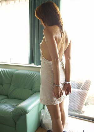 Submissive asian babe Karen Kisaragi posing barely clothed