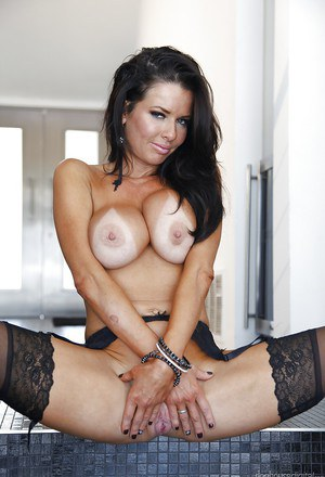 Ravishing MILF Veronica Avluv taking off her dress and lacy lingerie