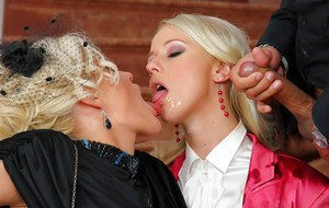 Steaming hot blonde MILFs have a fully clothed threesome with a lucky guy