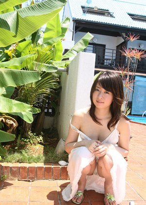 Stunning asian babe with nice tits Risa Misaki stripping by the pool