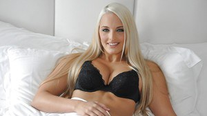 Sexy blonde amateur Macy Lee stripping off her black lingerie on the bed
