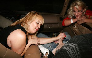 Lascivious mature blonde gives a sensual handjob in the car