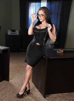Voluptuous brunette in glasses slowly uncovering her gorgeous curves