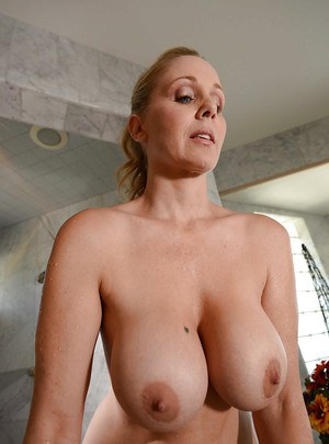 Tempting blonde MILF with big tits Julia Ann taking shower