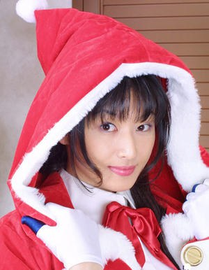 Seductive asian babe in christmass outfit uncovering her nice tits and bush