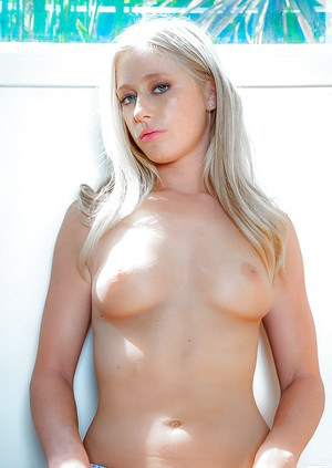Alluring blonde Stacy Aaron stripping off her top and panties