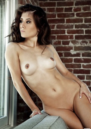 Skinny babe with shaved cooter Vanity Cruz taking off her lingerie