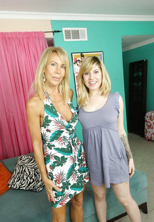 Mature bombshell teaching her teen friend how to handle with a giant dildo