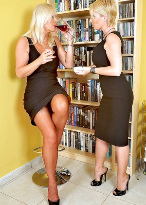 Hot mature lady in glasses has some foot fetish fun with her female friend