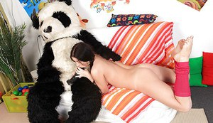 Petite brunette teen has some hardcore fun with her panda toy