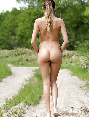 Sweet blonde babe with shaved pussy and hot ass posing naked outdoor