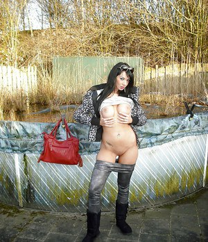 Lustful brunette babe in sunglasses uncovering her fuckable curves outdoor