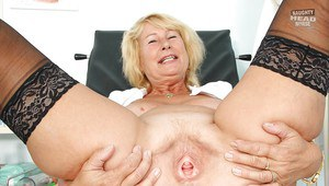 Mature nurse in stockings taking off her uniform and exposing her cunt
