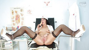 Lustful mature nurse stuffing her pink cunt with dildo and gyno tool