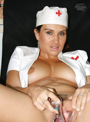 Seductive babe in nurse uniform masturbating her trimmed cunt by her toys