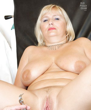 Buxom mature blonde gets her cunt stretched by gyno's fingers and tools