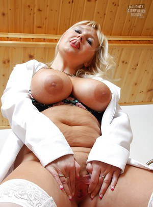 Fatty mature nurse with big jugs licking her nipples and toying her twat