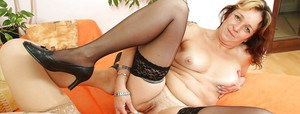 Mature lesbians with hairy twats playing with a double-side dildo