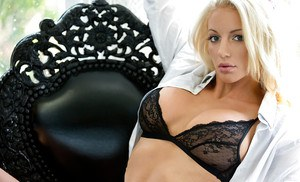 Bosomy blonde vixen Nicolette Shea slipping off her lingerie top