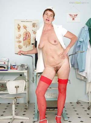 Short-haired mature nurse taking off her panties and spreading her legs