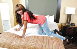 Fuckable ebony teen Mona Bella stripping on the bed and spreading her legs