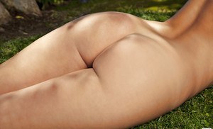Stunning blonde Tashia Lafon uncovering her gorgeous curves outdoor
