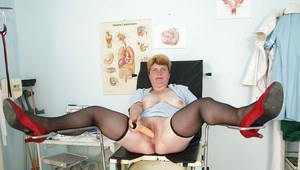 Chubby mature nurse with massive flabby jugs toying her cunt