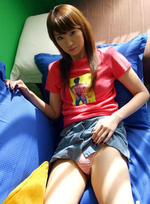 Petite asian girl with hairy poon stripping off her clothes