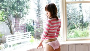 Charming teenage asian cutie uncovering her tempting tiny curves