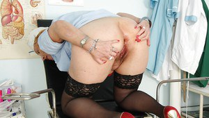 Nasty mature nurse in stockings showcasing her flabby tits and bushy cunt