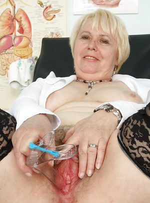 Fatty mature blonde in stockings spreading her legs and toying her twat